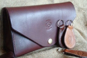 Devon Leather Envelope Clutch, with keyrings for scale.